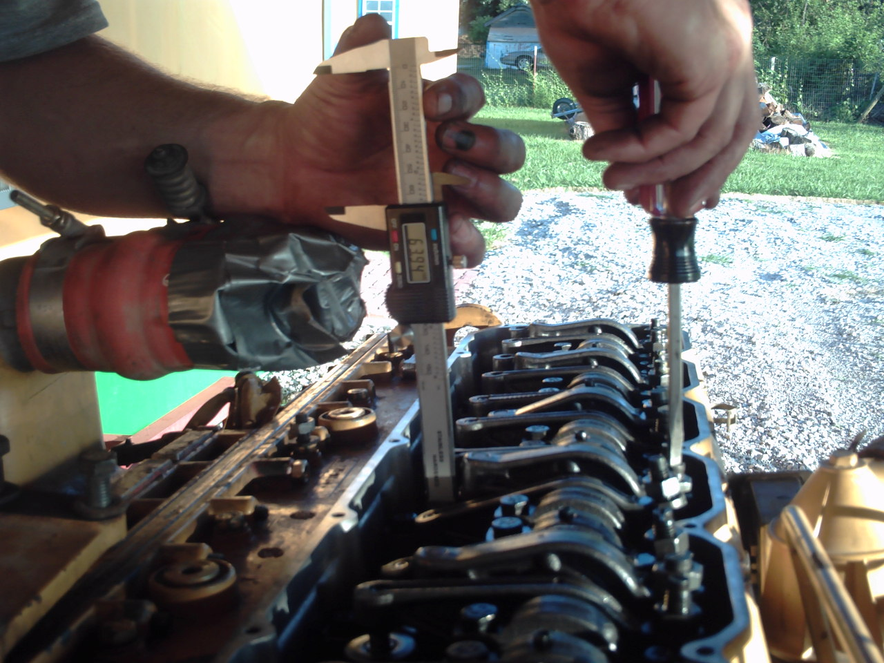 (7) Setting the injector timing is simply a matter of using a caliper to  measure the height of the injector's spring.