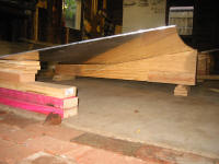 Plywood cradle supporting bottom sheets.