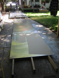 Laying out the pattern on the aluminum sheet.
